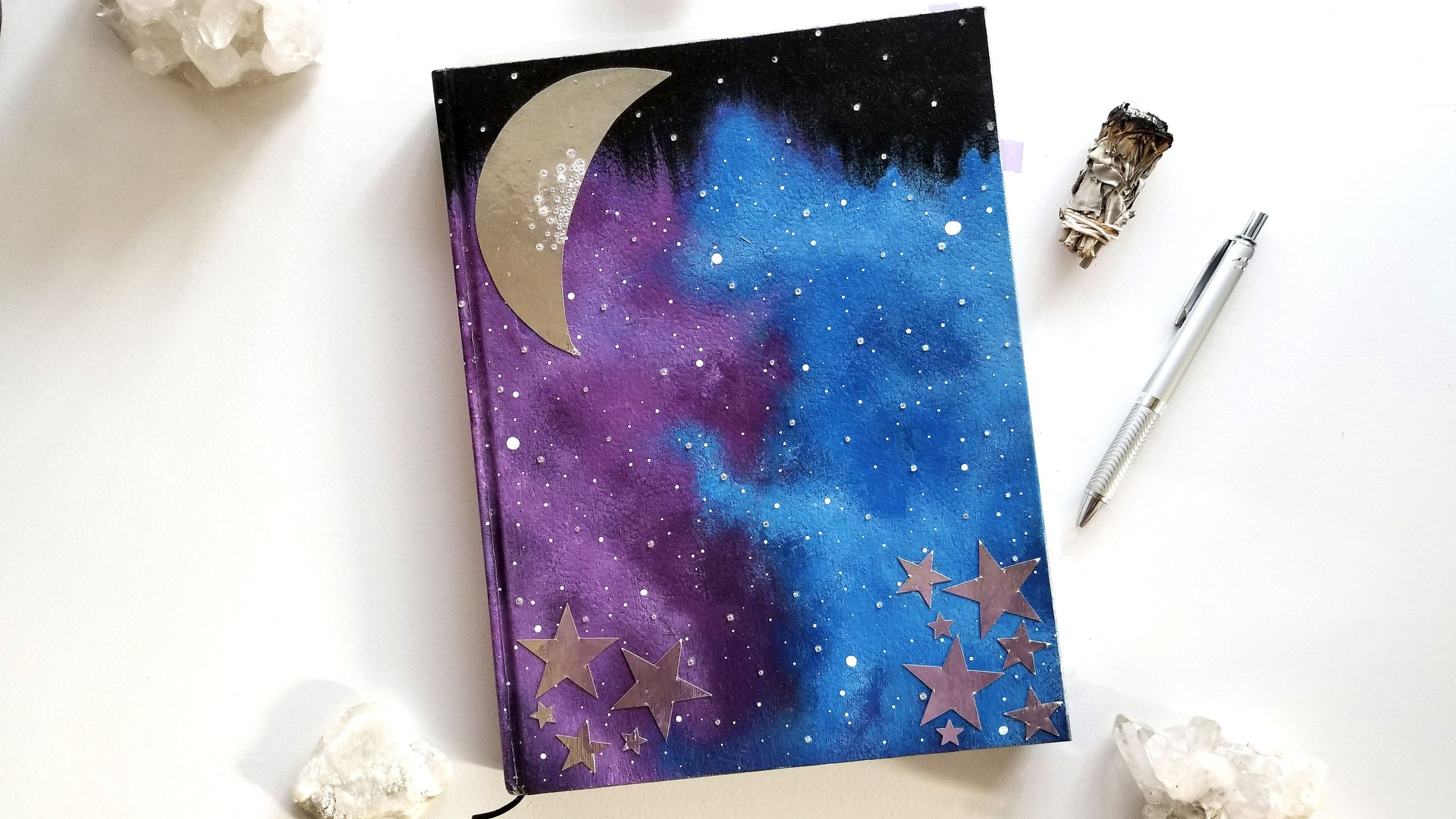 witch-galaxy-journal-with-silver-crescent-moon-and-rhinestones-surrounded-by-crystals
